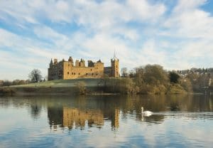 Linlithgow Palace and St Michael's Parish Church by Linlithgow Loch
